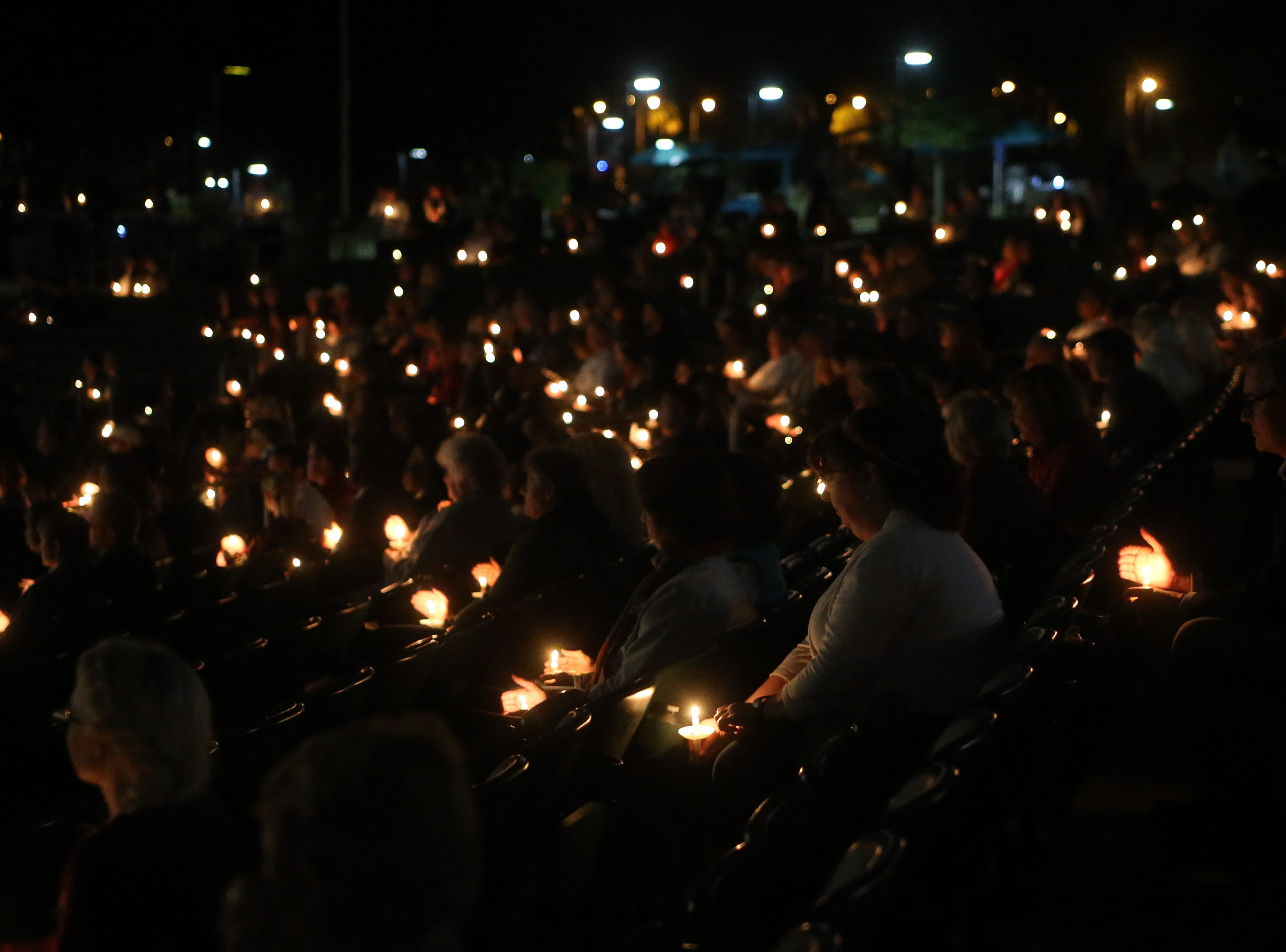 Hundreds gather for a vigil at the Hope, Healing, Harmony community event in honor of  Maura Binkley and Nancy Van Vessem, the two women who were killed during the shooting at Hot Yoga Tallahassee. The vigil was held at Cascades Park, Sunday, Nov. 11, 2018.