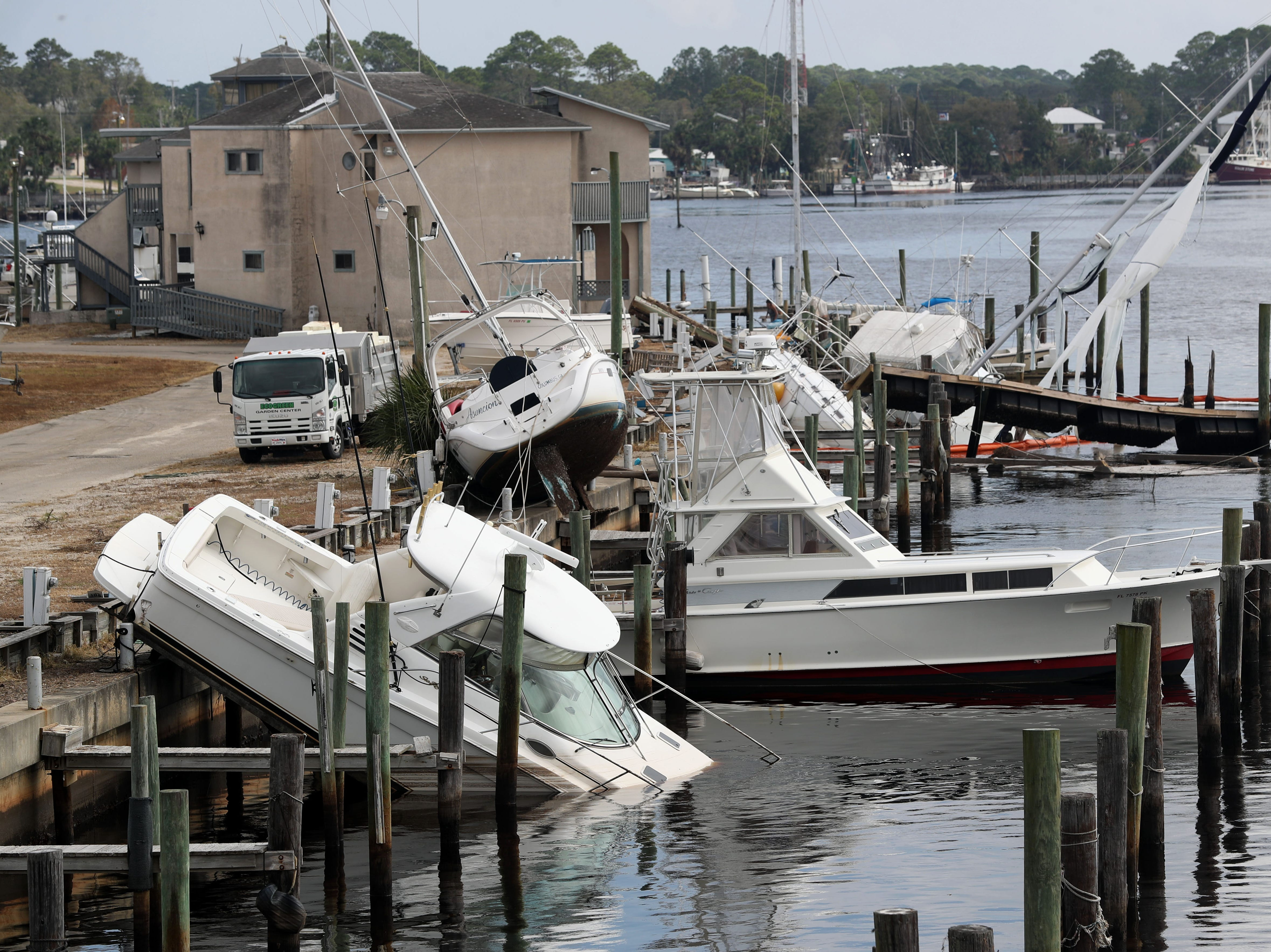 Boats at the Carrabelle marina toppled over and partially submerged after Hurricane Michael ripped through the panhandle on Wednesday, Oct. 10, 2018.