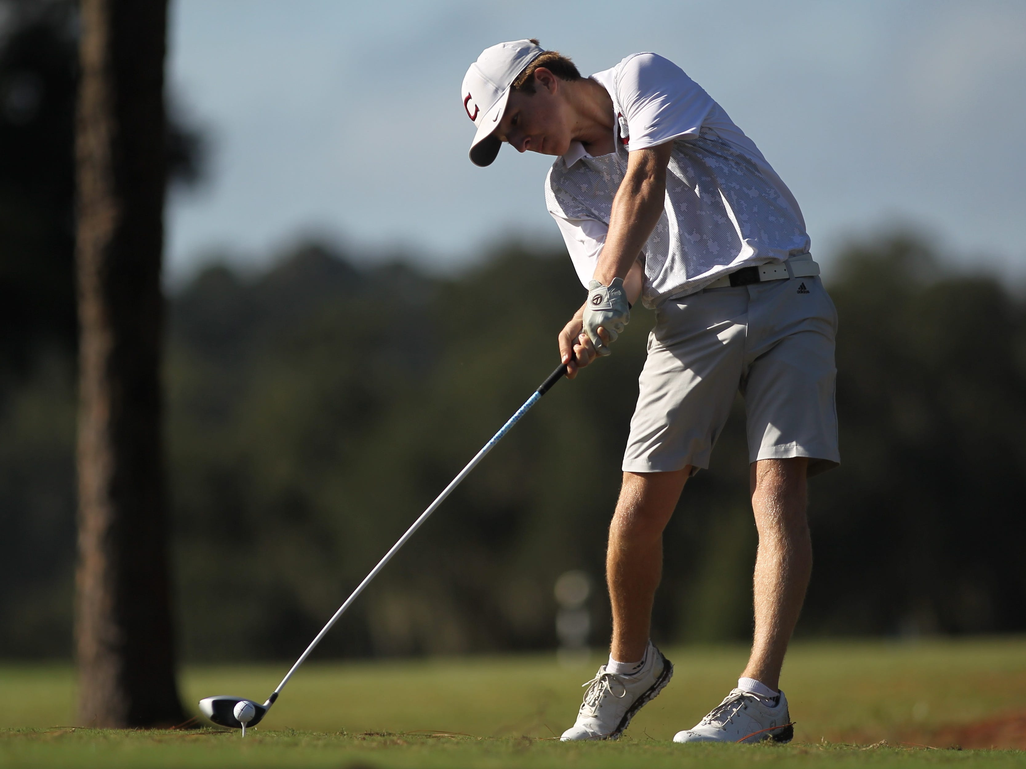 Chiles High sophomore Drew Miller displays the point of impact on a drive during October's City Championship at Hilaman Golf Course.