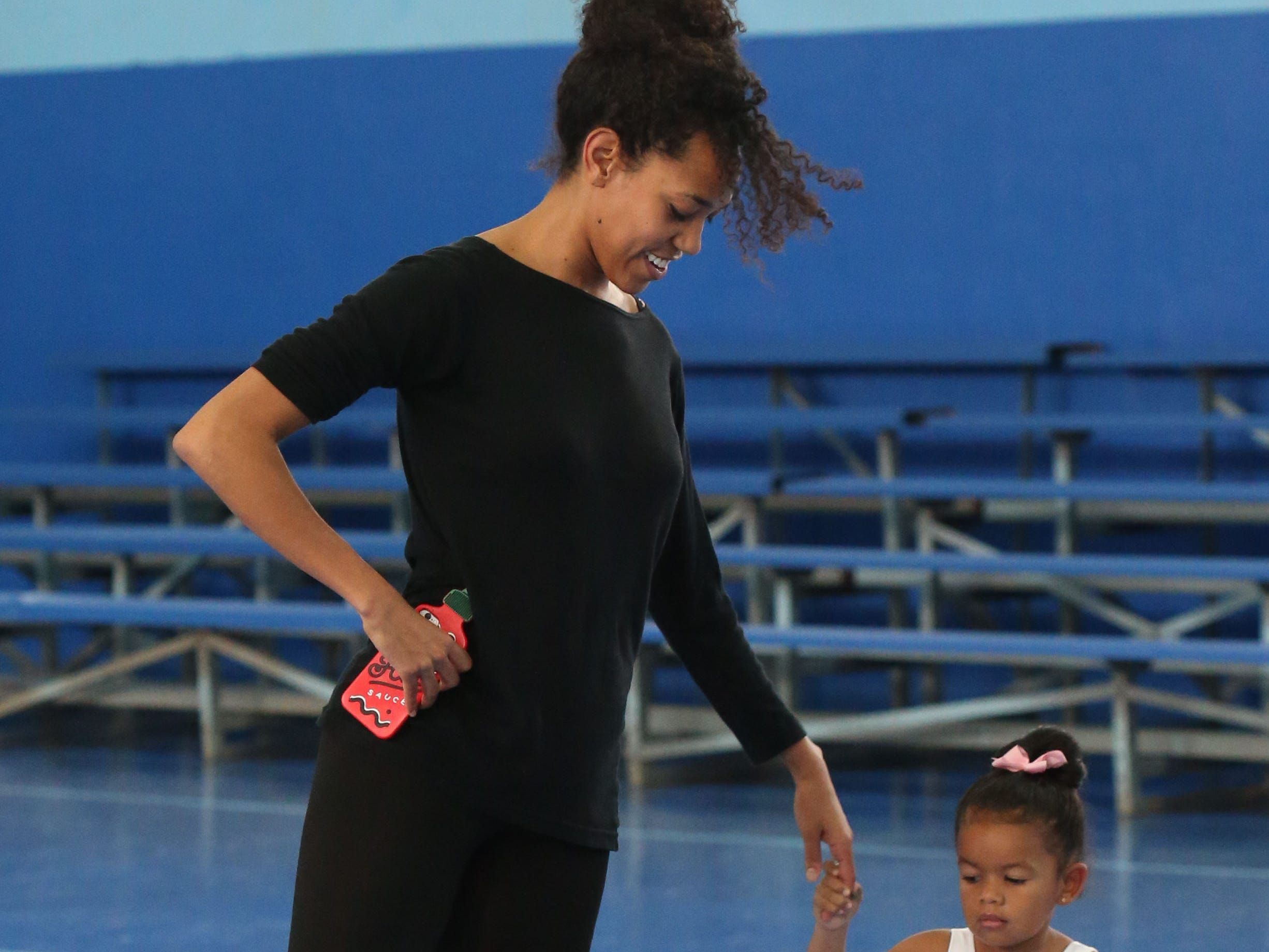 Lindsey Croop, a dancer from the School of Dance in Harlem, teaches Gabriela Young, 3, ballet at a dance class in Quincy, Fla., Saturday, Dec. 8, 2018.