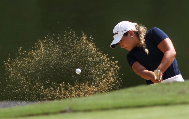 Aucilla Christian senior Megan Schofill blasts out a green-side bunker during the boys' Big Bend Championships at Southwood Golf Club. Schofill finished in ninth place.