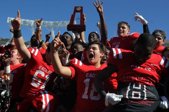 North Florida Christian's football team celebrates a Class 2A state championship on Dec. 7, 2018 inside Camping World Stadium. The Eagles beat Champagnat Catholic 28-20 to capture the program's eighth state title.