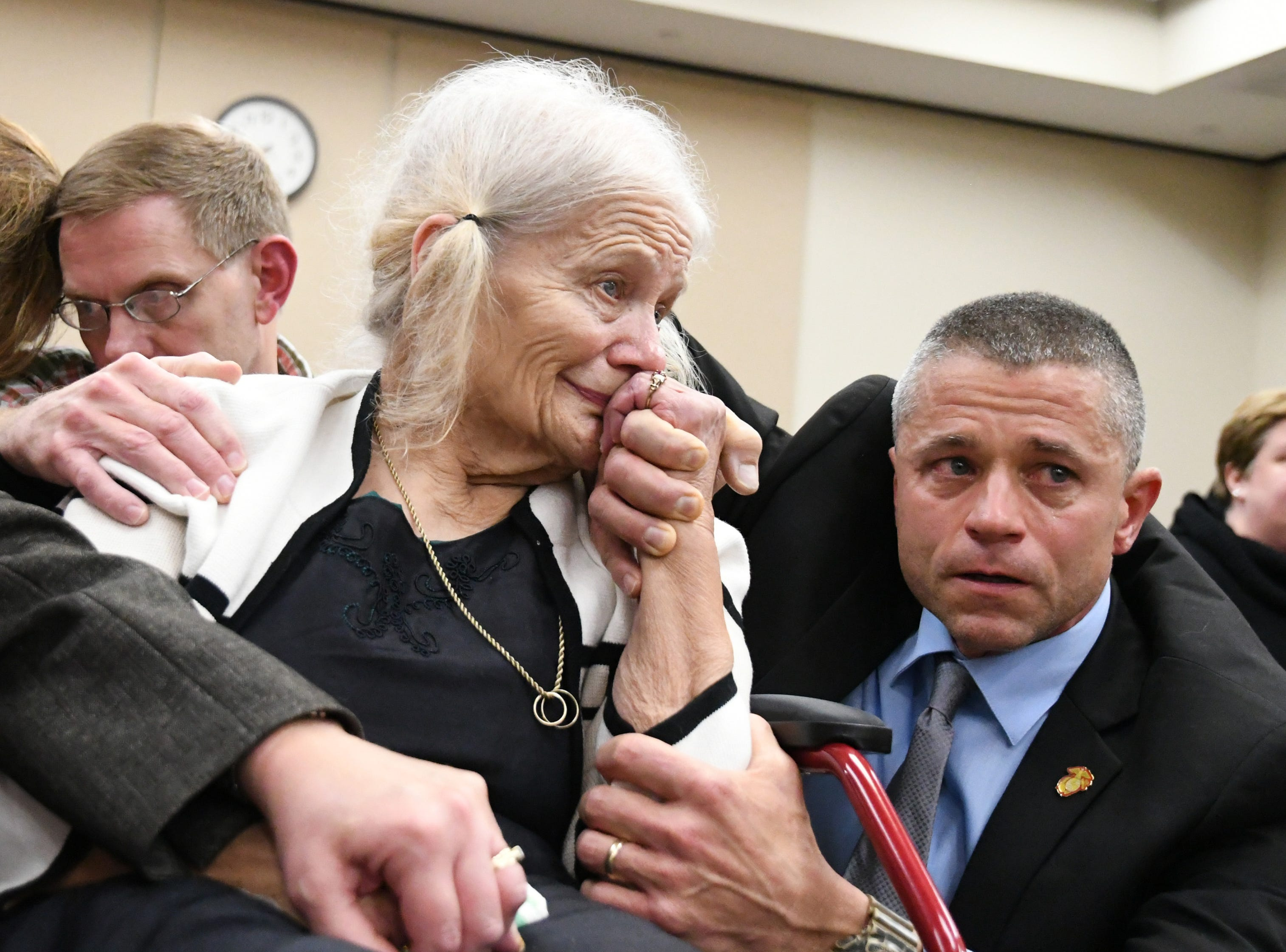 Cheryl Williams, left, mother of Mike Williams, the man who was shot and killed by his best friend, Brian Winchester 18 years ago, along side family friend Josey Visnovske, cry tears of joy for a the guilty verdicts in the trial against Denise Williams, Mike's former wife, Friday, Dec. 14, 2018. Nick Williams, brother of Mike Williams, rests his head against his wife's head while gripping on to his mother's shoulder.