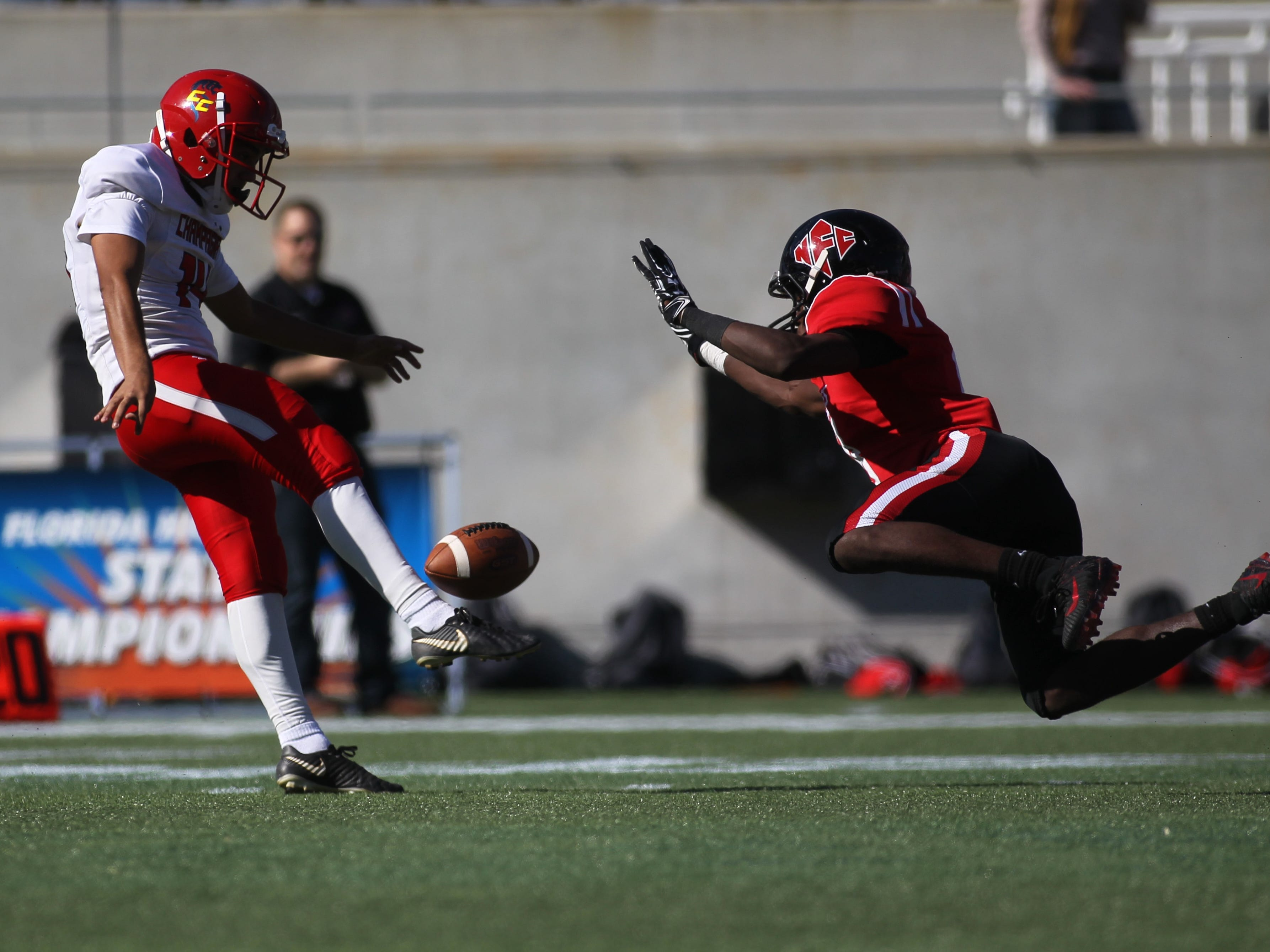North Florida Christian's Deandrae McCray lays out to block a Champagnat Catholic punt during the Class 2A state championship game on Dec. 7, 2018. McCray tipped the punt, and the Eagles won 28-20 to capture the program's eighth state title.