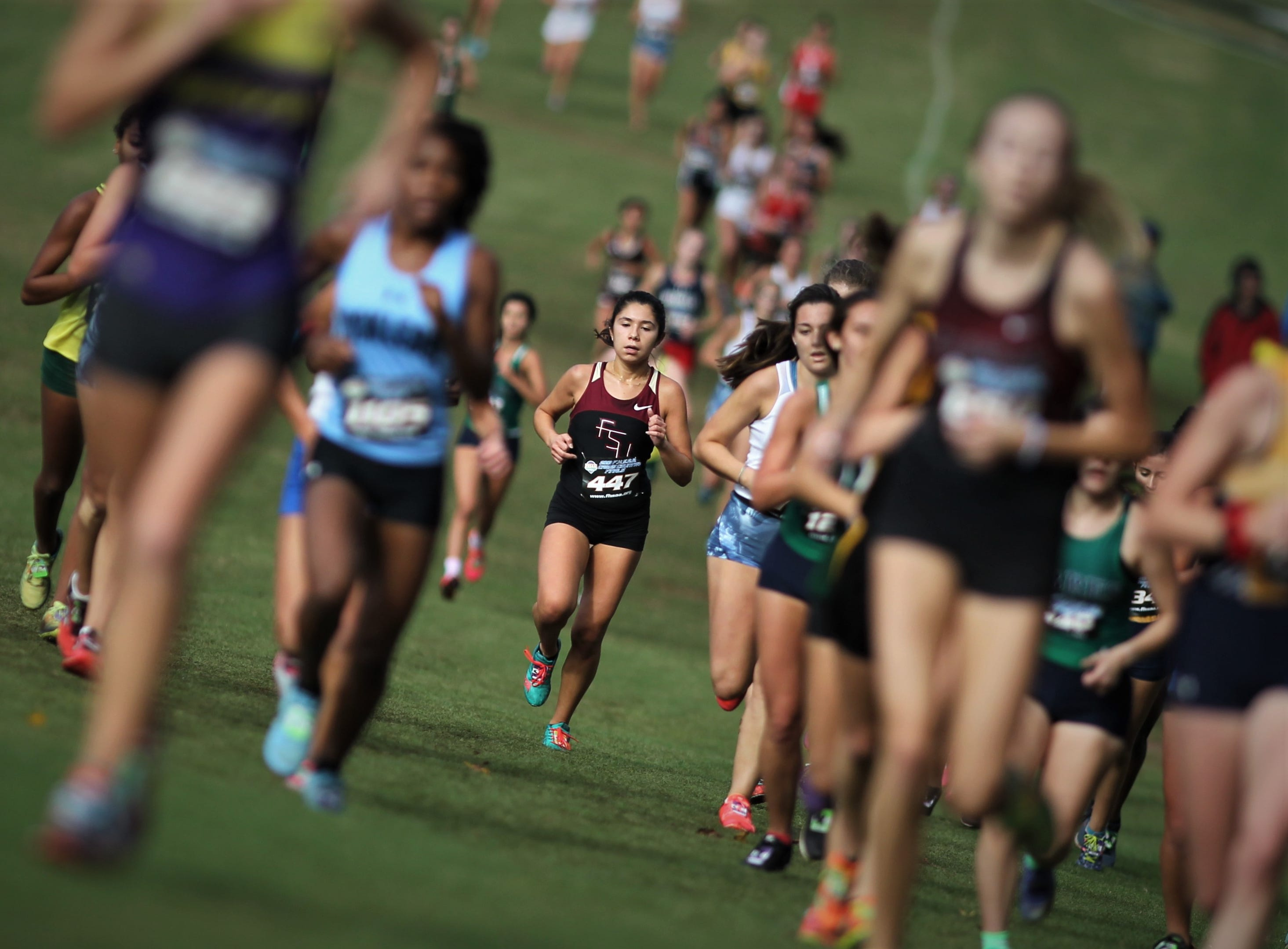Florida High senior Summer Williams runs in a pack of runners during an FHSAA State Championships race at Apalachee Regional Park on Nov. 10, 2018.