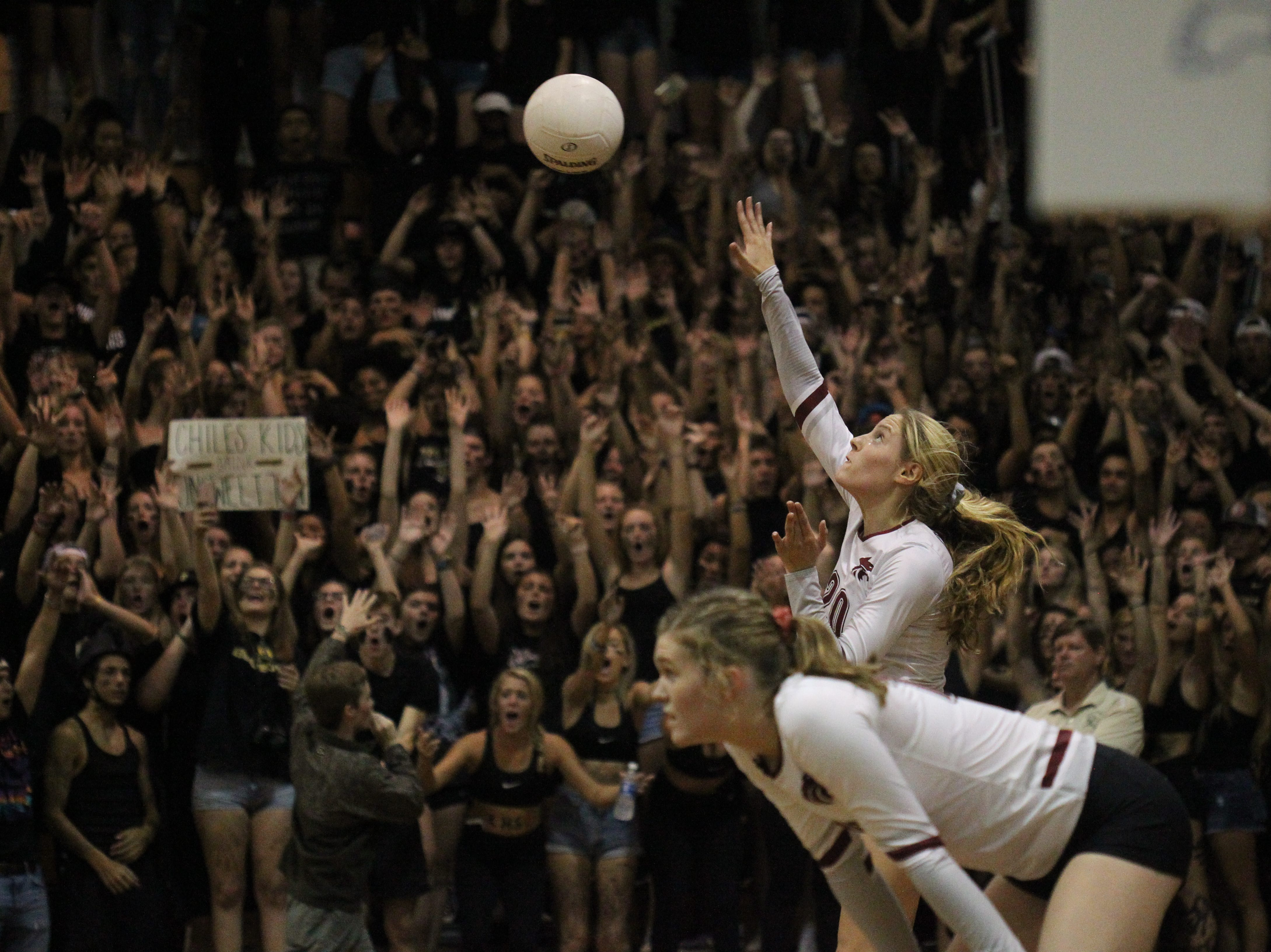 Chiles High senior Kelsey Mead serves in front of a sea of Lincoln High students during a regular-season game at Chiles on Aug. 29, 2018.