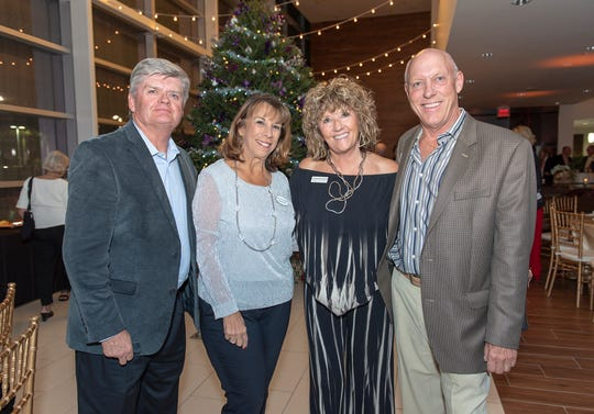 Terry and Paula Scheid, left, with Jacqueline and Bill LaLone. The LaLones opened their home to participants in the Holiday Home Tour.