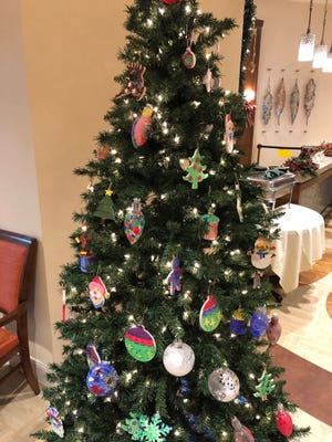 What a beautiful tree,filled with handmade ornaments.