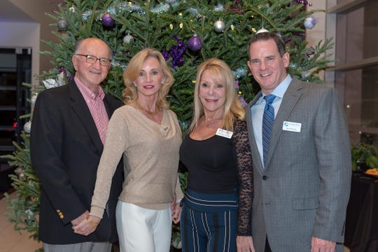 Dean and Laura Crawford, left, and Christina Tucker and Joe O'Grady at the VIP party. The Crawfords' home was on the Holiday Home Tour.