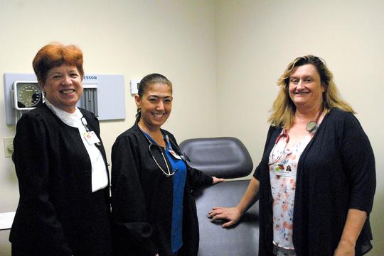 Vicki Soule, CEO of TCCH; Yanet Quevedo and  Dr. Jennifer Moore