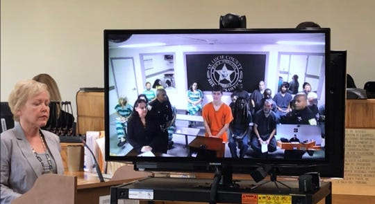 Tanner Dasnher, in orange, at first appearance hearing