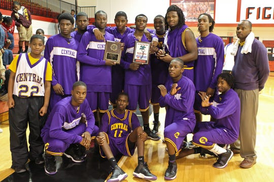 Fort Pierce Central players and coach James Dawson (back row, far right) celebrate their second consecutive Holiday Hoopla title in 2010, defeating Vero Beach in what remains the only final matching area teams.