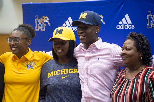 "Martin County quarterback George Johnson signed his National Letter of Intent to play football at the University of Michigan on Wednesday, Dec. 19, 2018, during a signing ceremony at Martin County High School in Stuart. ""I think it feels amazing, I think it's a dream come true,"" Johnson said. Johnson initially committed to Michigan in June. ""I've been waiting for this,"" he said."