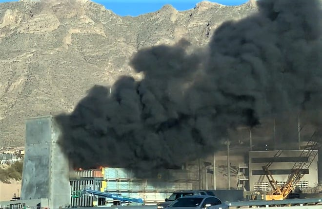 Smoke billows from a building on fire on Vin Rambla Drive along Interstate 10 on El Paso's West Side on Wednesday, Dec. 19, 2018. The site appears to be the building in which indoor-skydiving company Flyzone was set to be located.