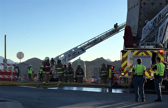 El Paso Fire Department crews work to put out a blaze at the West Side site of the future iFLY Indoor Skydiving facility on Wednesday, Dec. 19, 2018.