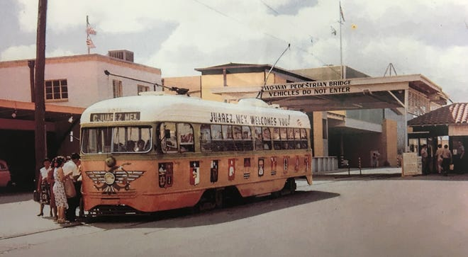 An original photograph of PCC Streetcar #1511 arriving in Juarez. Paintings by Jose Cisneros can be seen along the side of the car.