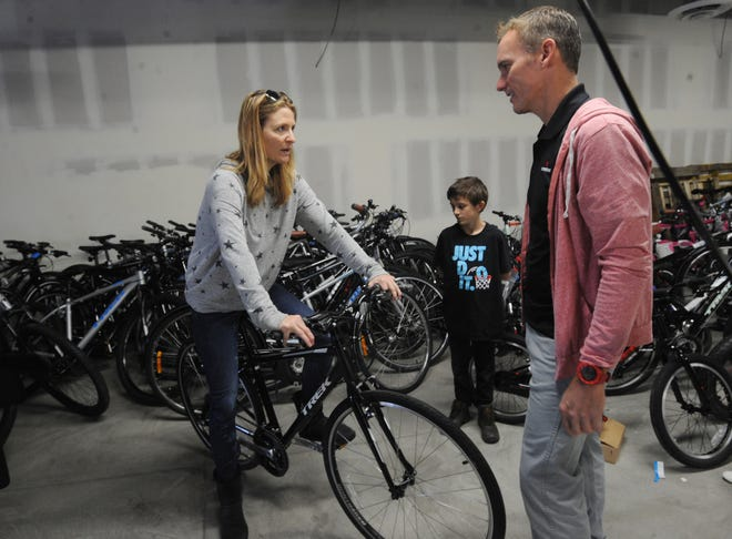 Danny Lupold, store manager of Trek Bicycle Westlake Village, gives a bicycle to Chandra Fortier and her son Jameson Fortier. Lupold put a group together in an effort to give away 200 bicycles donated by the Trek Bicycle Corp. and its subsidiary Electra to those affected by the Hill and Woolsey fires. The Fortiers lived in Cornell, an unincorporated community in the Santa Monica Mountains.