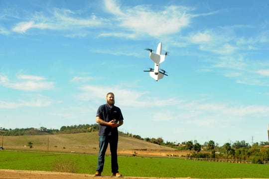 The Quantix drone being demonstrated by Eric Thompson, the flight operations manager of commercial information solutions for AeroVironment, was used by the National Park Service to analyze plant health during the recent Woolsey Fire.