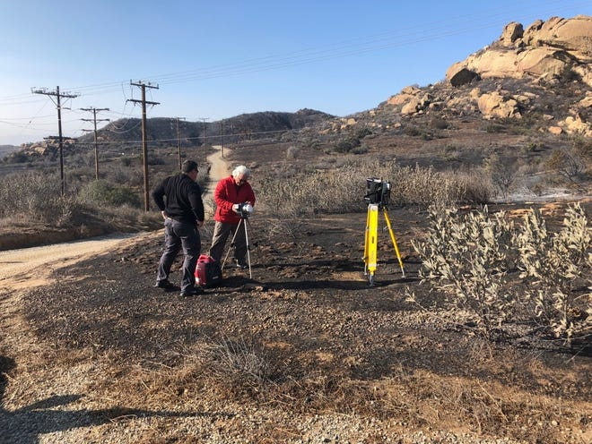 Officials set up air sampling equipment on Nov. 10 at the Santa Susana Field Laboratory to measure air contaminants after the Woolsey Fire burned portions of the site.