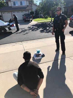 Oxnard police arrested a suspected package thiefafter a neighbor reported suspicious activity on Tuesday.