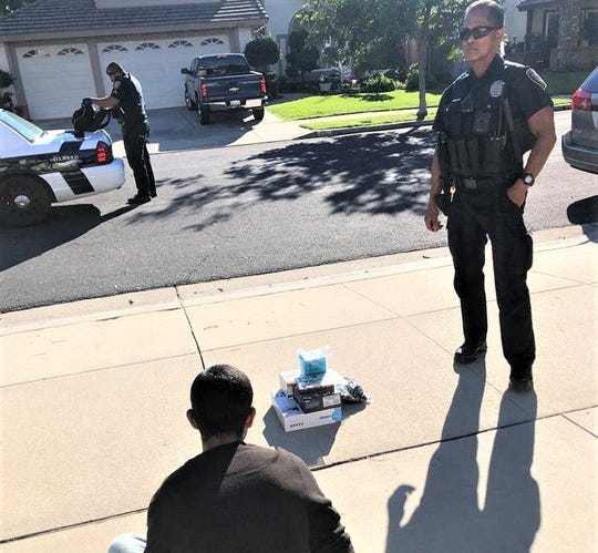 Oxnard police arrested a suspected package thief after a neighbor reported suspicious activity on Tuesday.