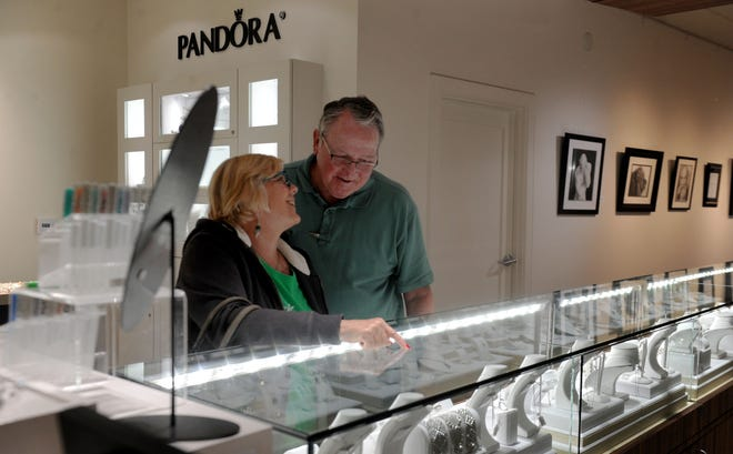 Sheila McCollum and her husband, Tom, shop at Fox Fine Jewelry. A year ago, the Thomas Fire cut into holiday profits for a number of downtown Ventura businesses.