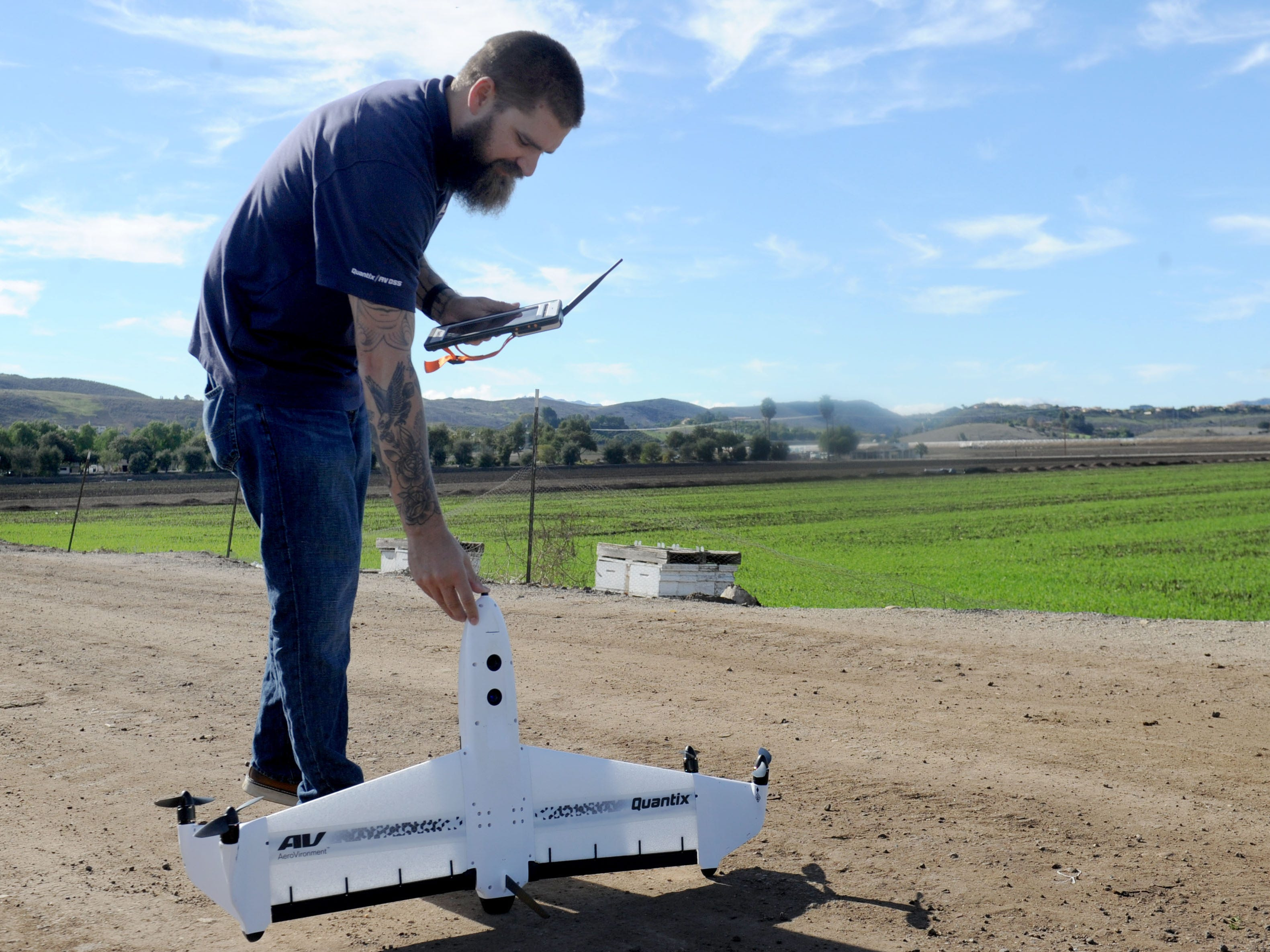 Eric Thompson, flight operations manager commercial information solutions for AeroVironment, gets ready to fly the Quantix drone on a open field in Moorpark. The Quantix is AeroVironment's first commercially available drone.