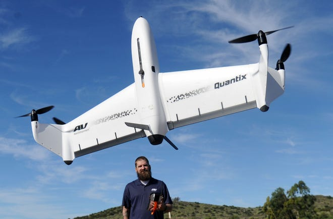 Eric Thompson, the flight operations manager  commercial information solutions for AeroVironment, flies the Quantix drone in an open field in Moorpark. AeroVironment, which already has operations in Ventura County, is moving its headquarters from Monrovia to Simi Valley.