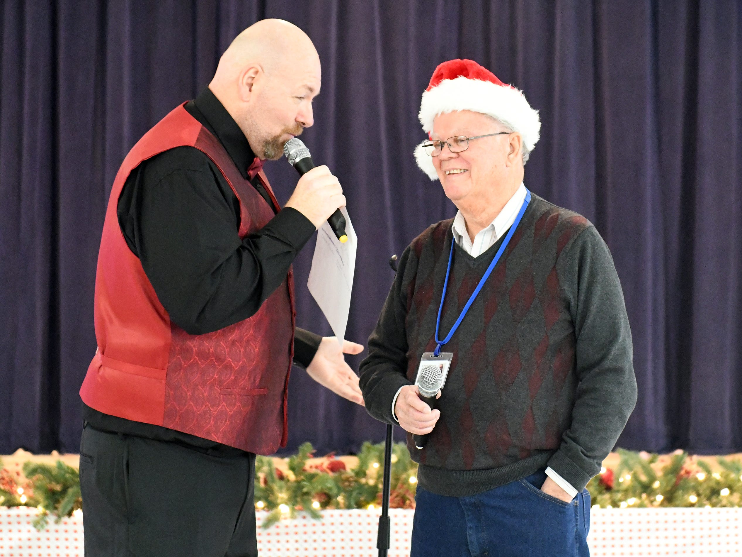 "N.J. Veterans Memorial Home senior therapy program assistant Derick Glenn (left), served as the master-of-ceremonies during the eighth annual ""Second Wind Dreams"" celebration on Wednesday, December 19, 2018."