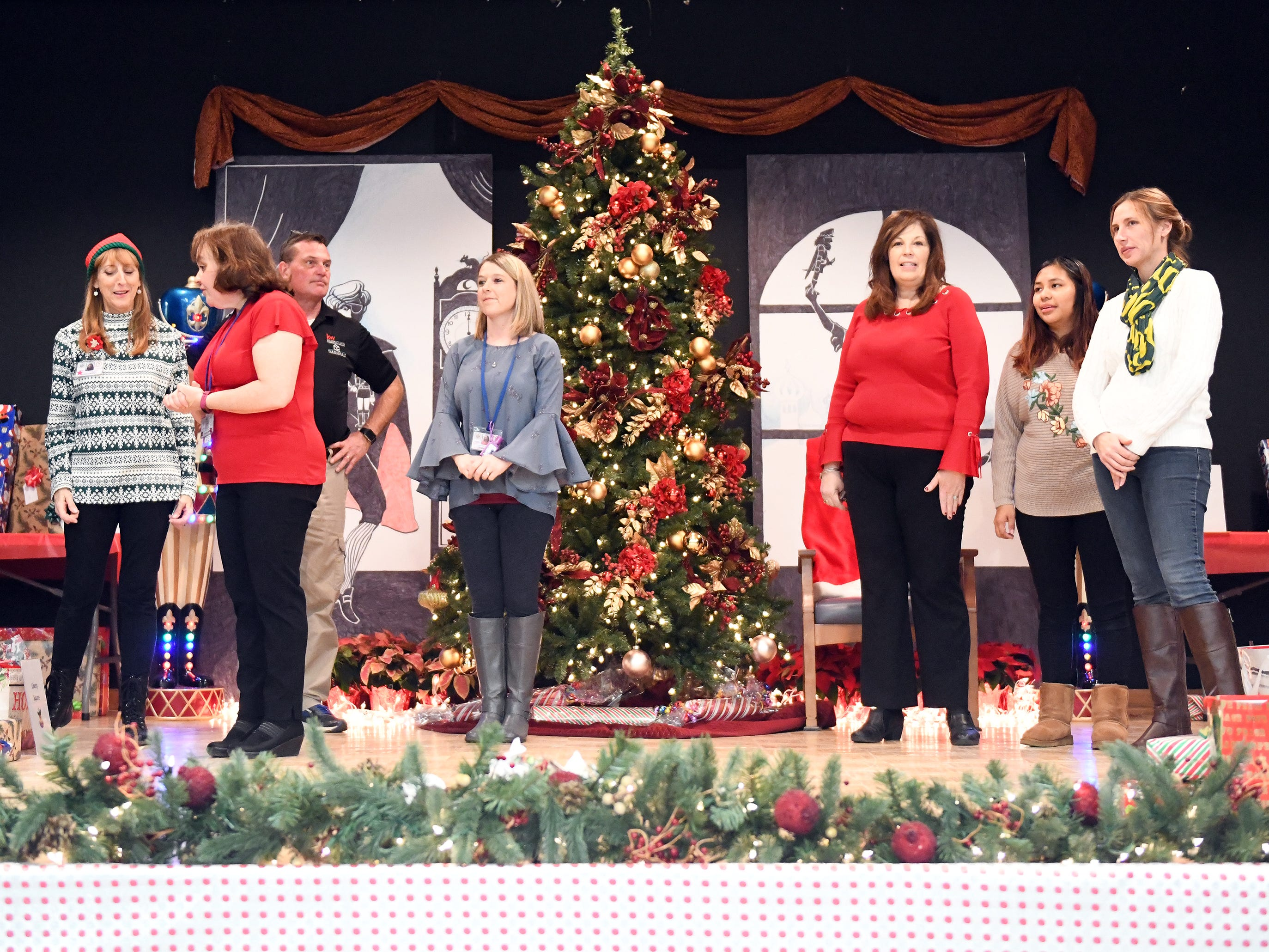"N.J. Veterans Memorial Home employees help hand out presents during the eighth annual ""Second Wind Dreams"" celebration on Wednesday, December 19, 2018."