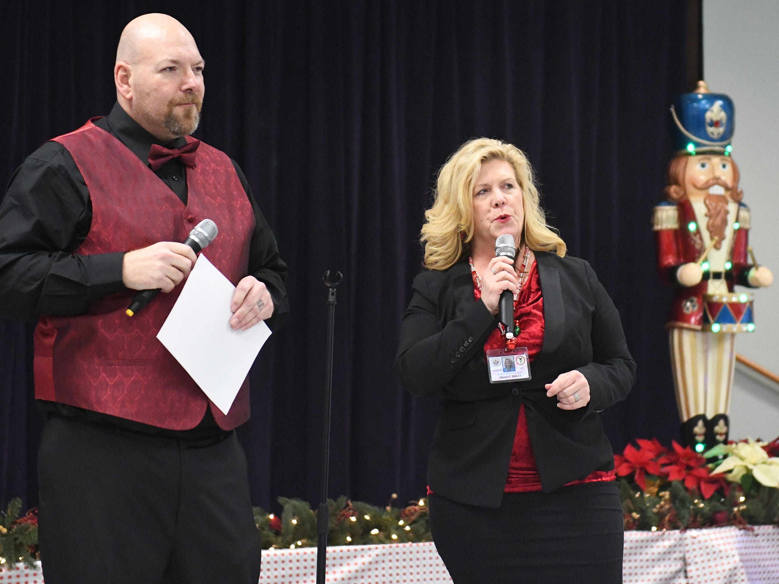 "N.J. Veterans Memorial Home CEO Allyson Bailey and Derick Glenn, senior therapy program assistant, speak to the crowd of residents during the eighth annual ""Second Wind Dreams"" celebration on Wednesday, December 19, 2018."