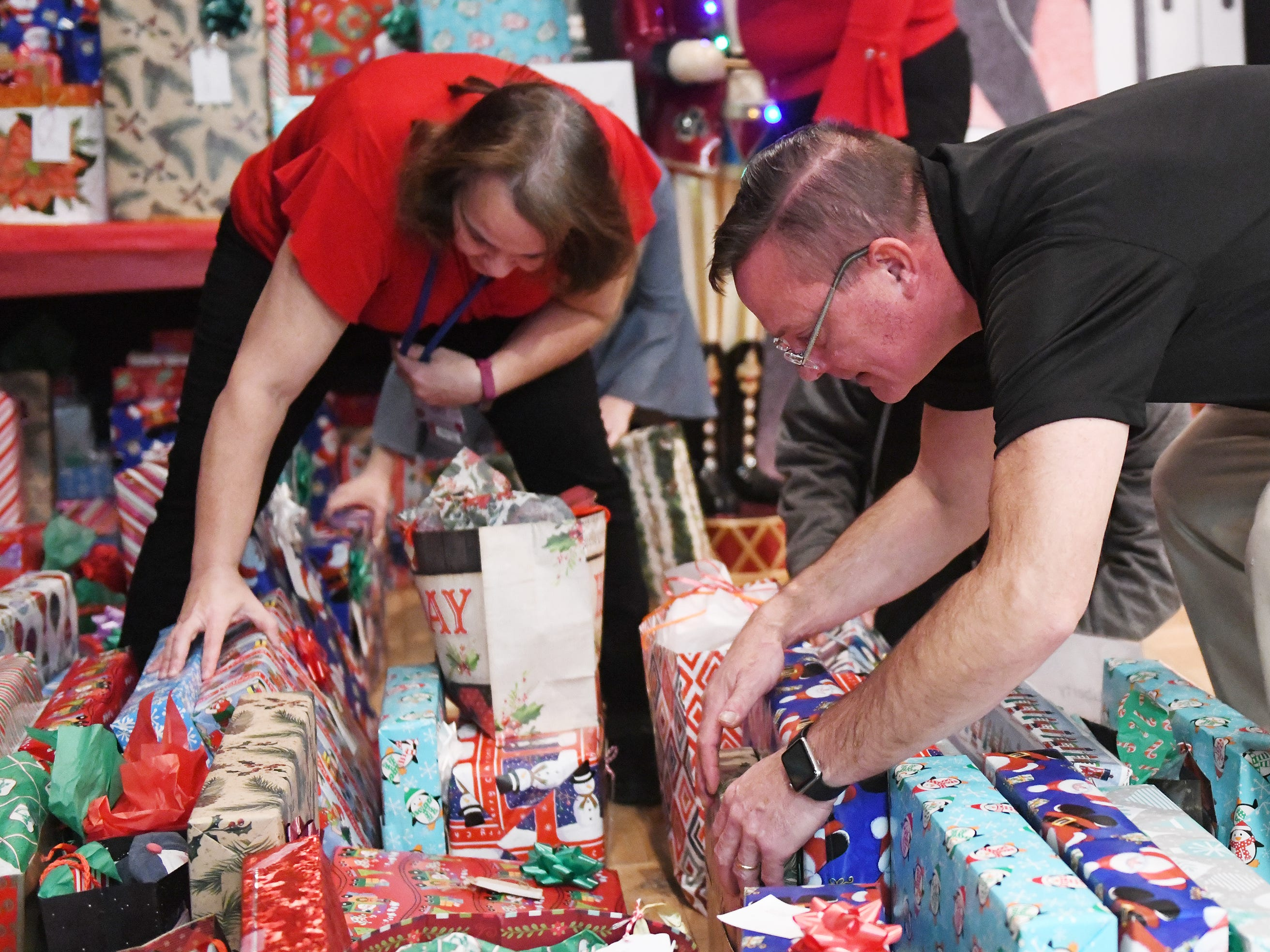 "N.J. Veterans Memorial Home employees and volunteers help hand out presents during the eighth annual ""Second Wind Dreams"" celebration on Wednesday, December 19, 2018."