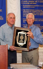The Vineland Rotary Club's Vocational Service Award recipient for 2018, Arthur Baruffi Sr. (left), is presented with a plaque recognizing his contributions to his profession and his community by Ed Morvay, the club's membership director.