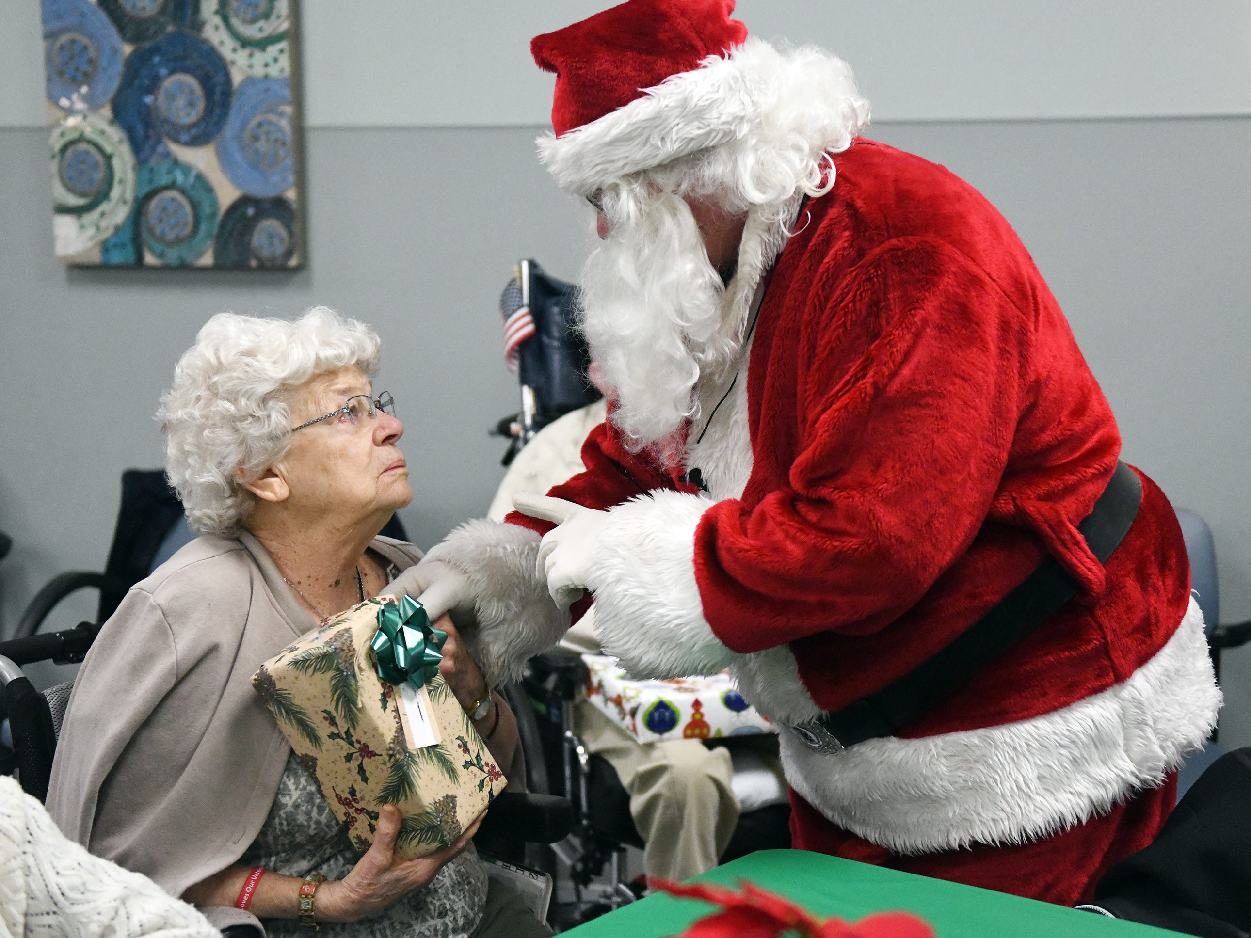"Santa helps hand out presents to N.J. Veterans Memorial residents during the eighth annual ""Second Wind Dreams"" celebration on Wednesday, December 19, 2018."