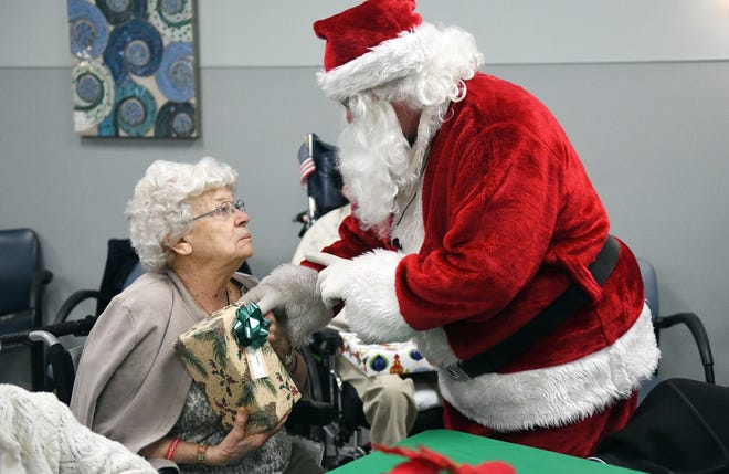 """Santa helps hand out presents to N.J. Veterans Memorial residents during the eighth annual """"Second Wind Dreams"""" celebration on Wednesday, December 19, 2018."""