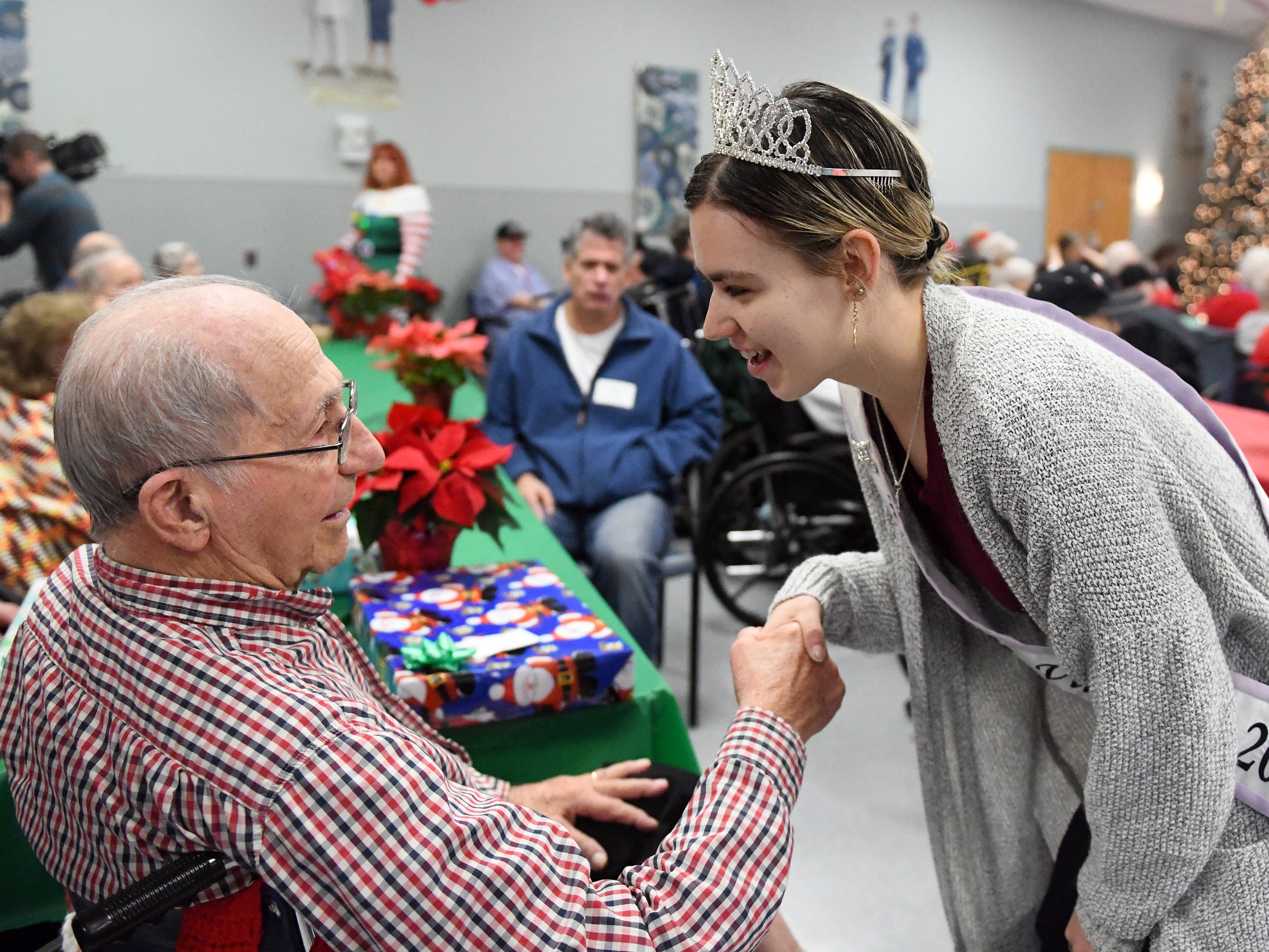 "Miss Vineland 2018, Sarah Layton, talks with N.J. Veterans Memorial Home residents during the eighth annual ""Second Wind Dreams"" celebration on Wednesday, December 19, 2018."
