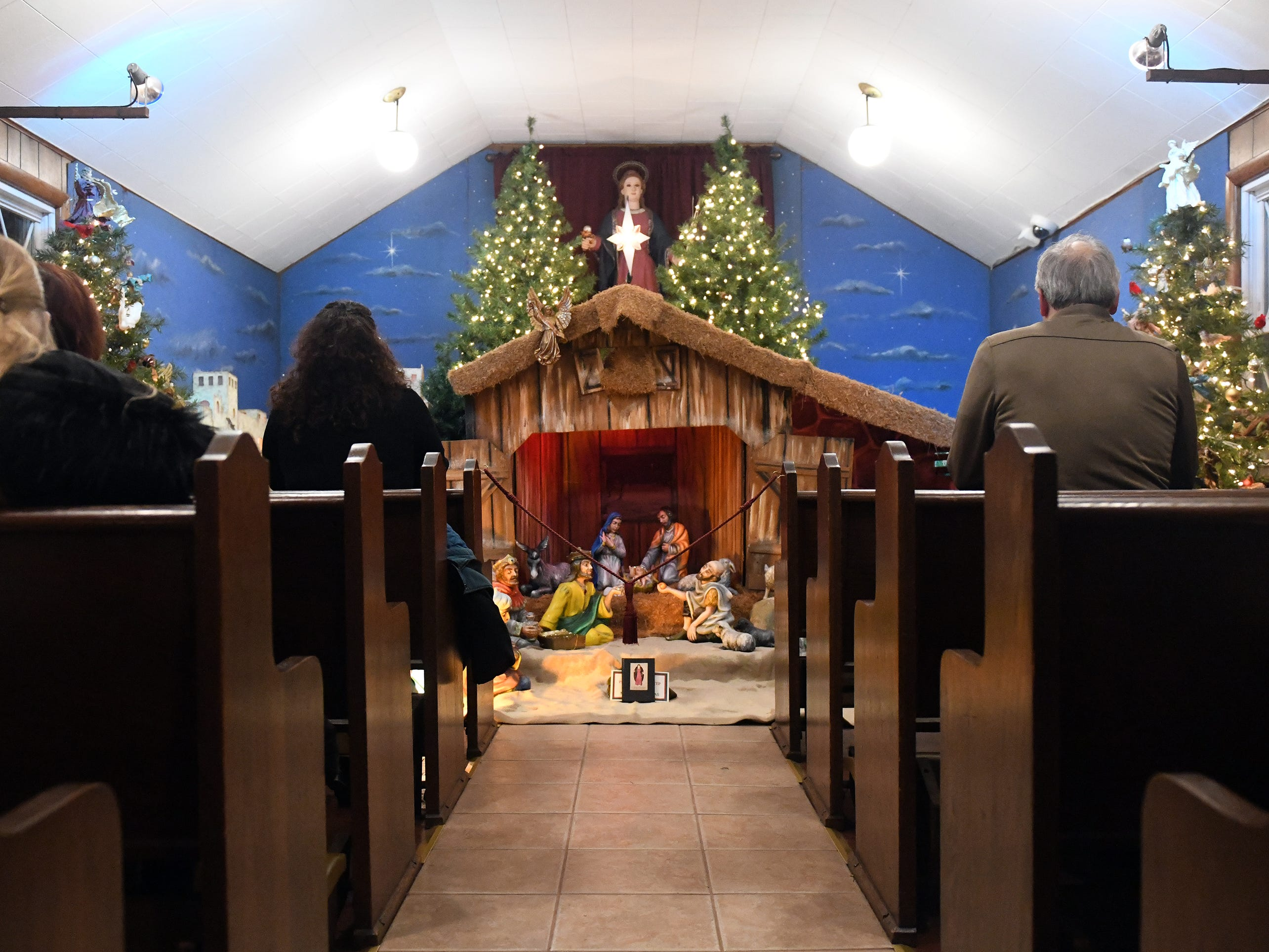 Parishioners gather at Saint Barbara RC Chapel of Vineland on 2334 East Oak Road, between Main and Brewster roads, to pray in honor of the Blessed Nativity of Christ and to sing Christmas hymns on Tuesday, December 18, 2018.