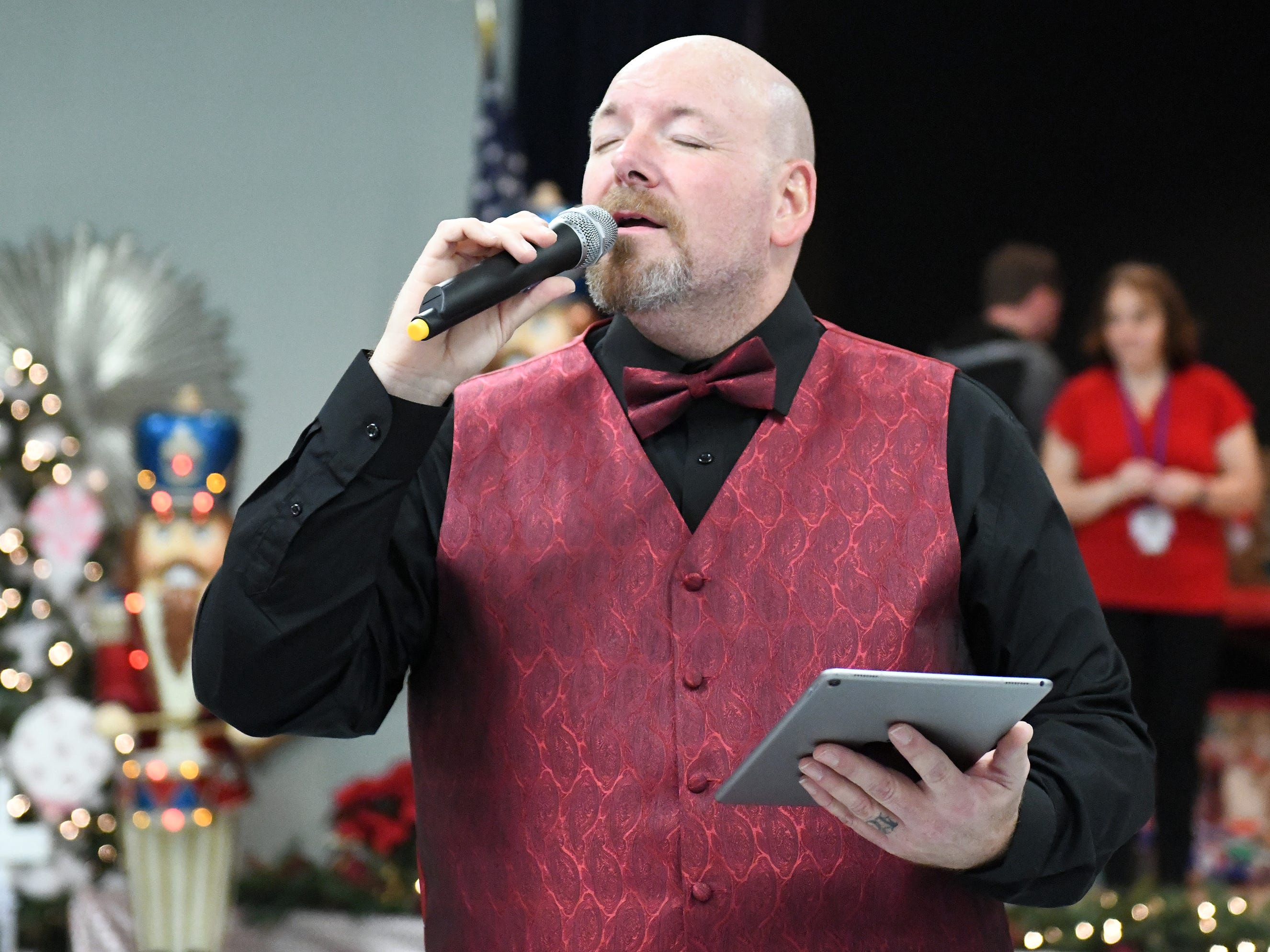 "N.J. Veterans Memorial Home senior therapy program assistant Derick Glenn served as the master-of-ceremonies during the eighth annual ""Second Wind Dreams"" celebration. He also sang Christmas songs throughout the event."