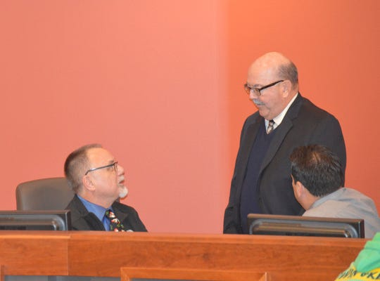 Rob Hunt, left, speaks to Tulare Council member Dennis Mederos, middle, and Mario Zamora, Tulare interim city attorney at this week's council meeting.