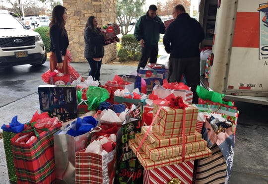 "Ruiz Foods team members and CASA of Tulare County collect gifts for 150 Tulare County children through the ""Adopt a Child Christmas Program."""