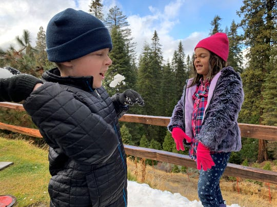 Children play in snow at Yosemite National Park.