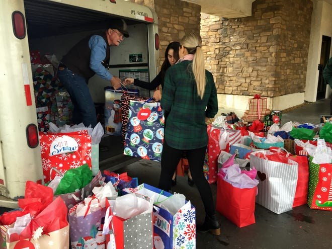 """Ruiz Foods team members and CASA of Tulare County collect gifts for 150 Tulare County children through the """"Adopt a Child Christmas Program."""""""
