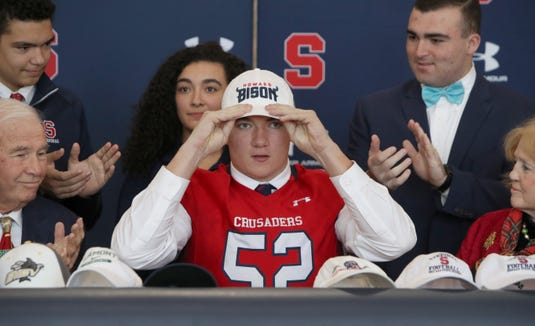 Football player James Price signs with Howard University during the signing day ceremony at Stepinac High School Dec. 19, 2018.