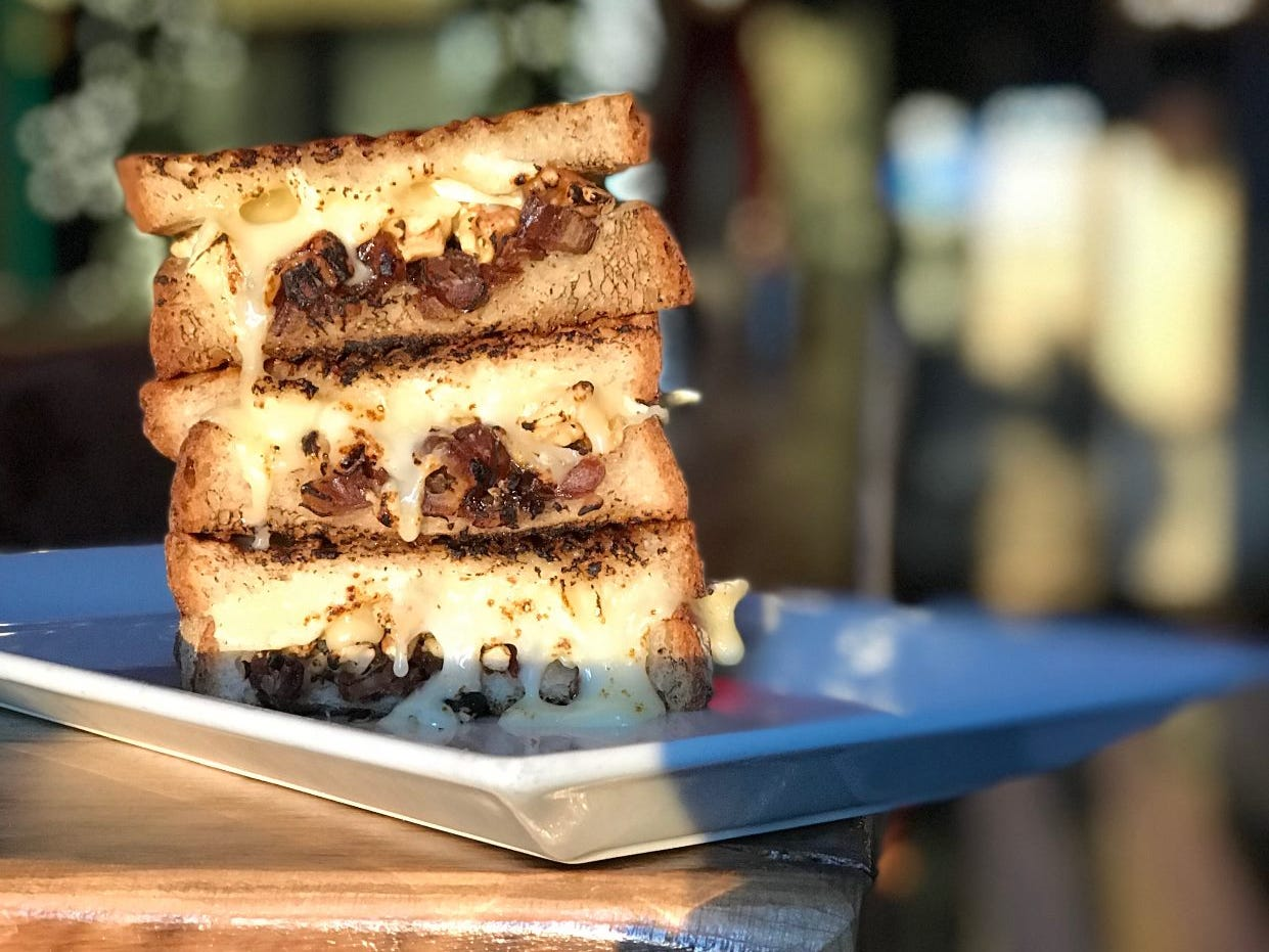 Brie Toastie from Saints and Scholars in Yonkers; made with parmesan, crushed walnuts and sea salt.