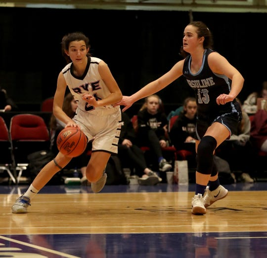 Amanda Latkany of Rye drives past Jane McCauley of Ursuline during a Slam Dunk Tournament basketball game at the Westchester County Center Dec. 19, 2018. Ursuline defeated Rye 72-42.