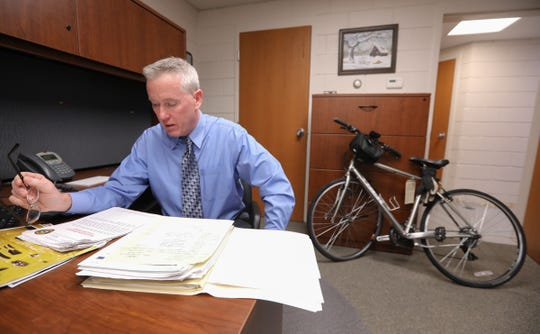 """Detective Robert Fitzgerald, looks over the case file of William """"Matt"""" George at Town of Ramapo Police Headquarters in Airmont on Wednesday, December 19, 2018."""