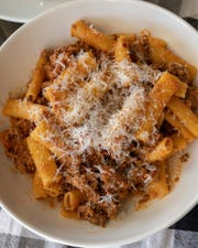 The Rigatoni Ragu at Norcina in New City is made with handmade noodles,  pork, lamb and beef ragu with rosemary and parmigiano.