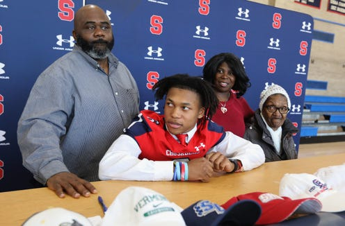 Football player Shawn Harris Jr. signs with Stonybrook University during the signing day ceremony at Stepinac High School Dec. 19, 2018.