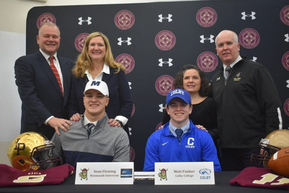 Sean Fleming (left) and Matt Panker are honored during a signing ceremony  Dec. 19, 2018 at Iona Prep in New Rochelle.