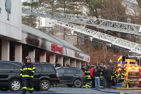 Firefighters put out a fire that went through the roof of Excelsior Cleaners at the Ferndale Center in Larchmont Dec. 19, 2018.